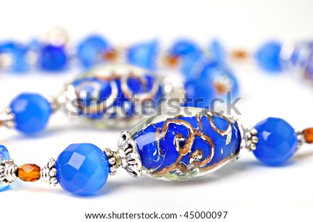 blue bead handmade with an abstract pattern on a white background - stock photo