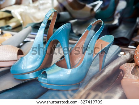 Blue beautiful women's shoes (no name of production) lie among other footwear