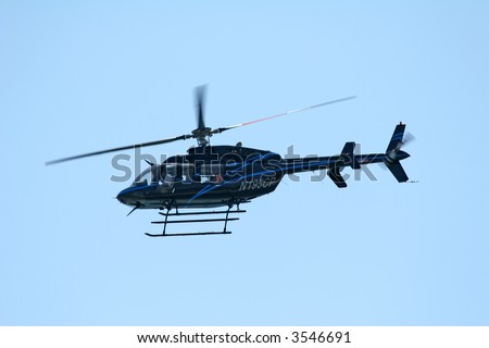 Blue Bell Helicopter with lighter blue stripes flying