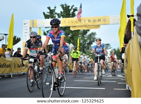 BLUE BELL, PA - AUGUST 19: Riders leave the start finish area, beginning their ride, in the Livestrong Challenge event August 19, 2012 in Blue Bell, PA. - stock photo