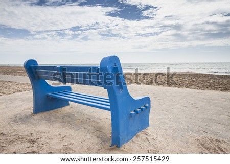 blue bench at a lonesome beach, concept for rest, relax and peace, Swakopmund, Namibia, Africa - stock photo