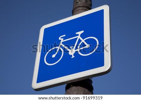 Blue Bike Sign on Lamppost - stock photo