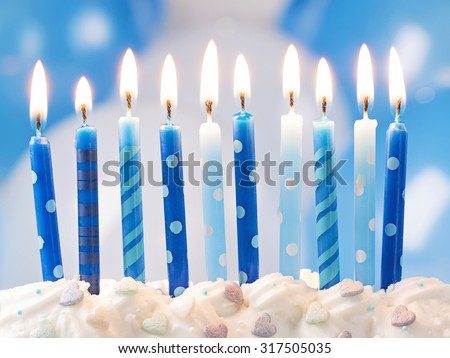 Blue birthday candles and balloons - stock photo