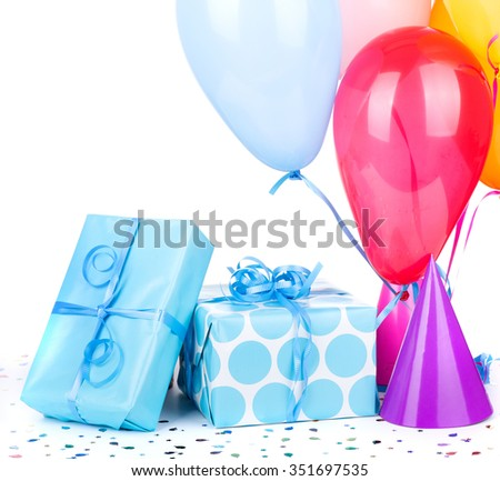 Blue birthday gifts with balloons and party hats on a white background - stock photo
