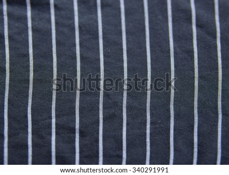 Blue-black and white stripes on the apron's background.