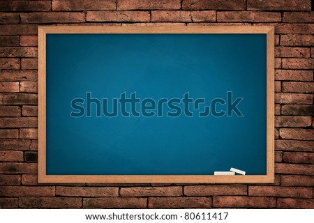 Blue blackboard on old wall background - stock photo