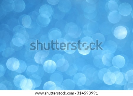 Blue blurred lights. Glittering abstract background - stock photo