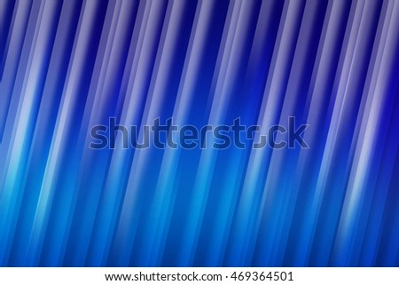 Blue blurred rays of light blend to create abstract background