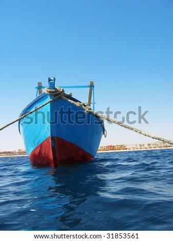 Blue boat at the harbor of Red Sea - stock photo
