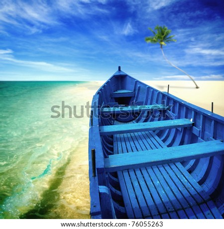 Blue boat on a beach - stock photo