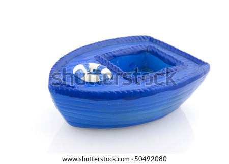 Blue boat with life buoy isolated over white