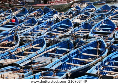 Blue boats in Essaouira port, Morocco  - stock photo