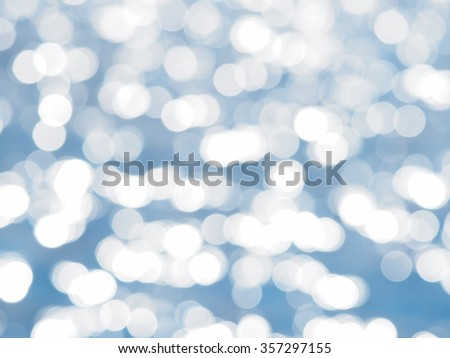 Blue bokeh abstract light background. Blurred Lights on blue background. Filtered color.