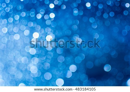Blue bokeh from light and raindrops