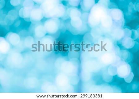 Blue bokeh glitter defocused lights abstract background - stock photo