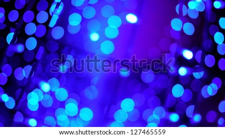 Blue Bokeh of Christmas Lights, Christmas and New Year Festival. - stock photo