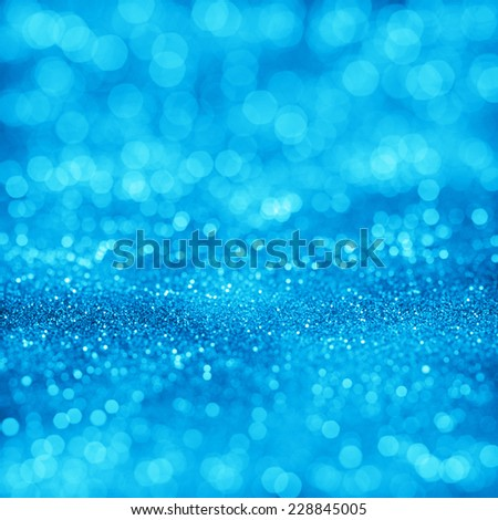 Blue bokeh texture. Festive glitter background with defocused lights - stock photo