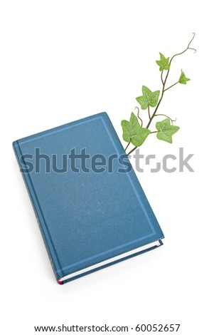 Blue book and sprout, education concept - stock photo