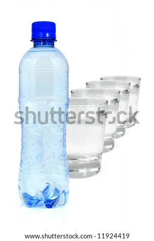 Blue bottle and four glasses of mineral water isolated on white - stock photo