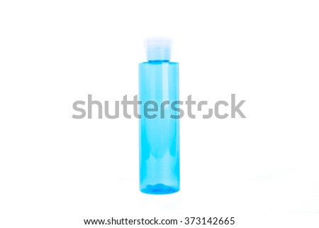 Blue bottle cosmetic isolated on white background