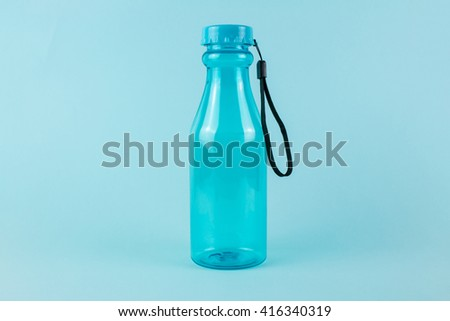 Blue Bottle of Water on Blue Background.
