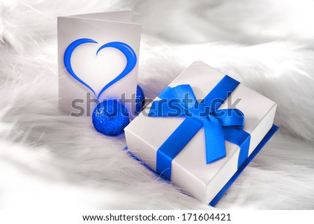 Blue bow holiday present - stock photo