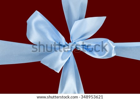 Blue bow on red background - stock photo
