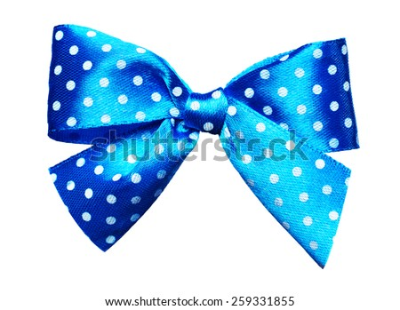 blue bow with white polka dots made from silk isolated