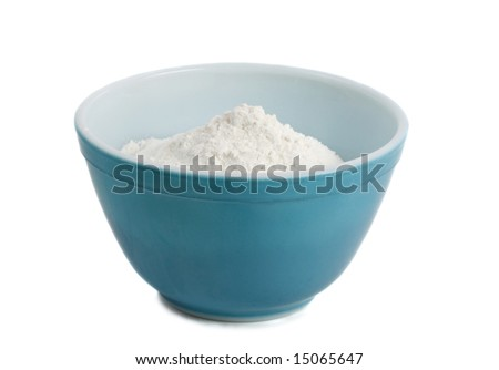 blue bowl filled with white flour, isolated on white - stock photo