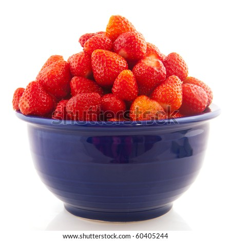 Blue bowl with clean washed strawberries isolated over white - stock photo