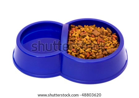 blue bowl with pure water and a dry feed for pets - stock photo