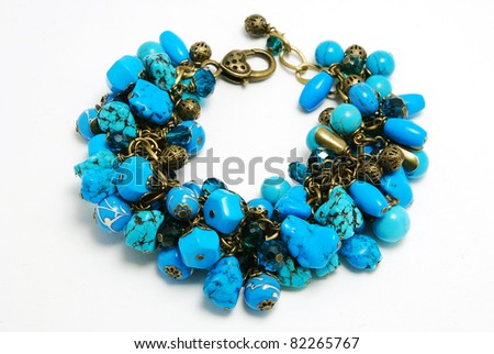 Blue bracelet with lampwork - stock photo