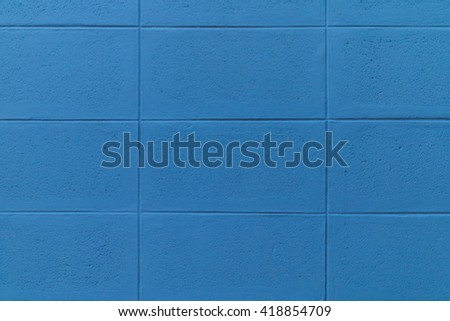 Blue brick wall seamless background, soft focus