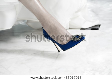 Blue Bridal Shoe on the Foot of a Bride - stock photo