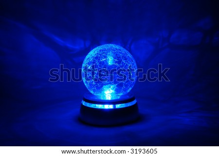 Blue bright crystal ball - stock photo
