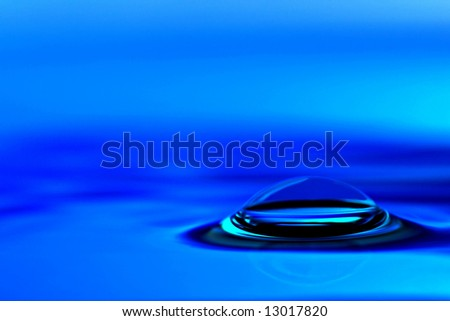 Blue bubble in blue water - stock photo