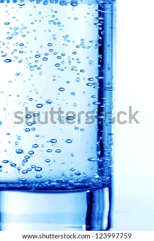 blue bubbled water in glass