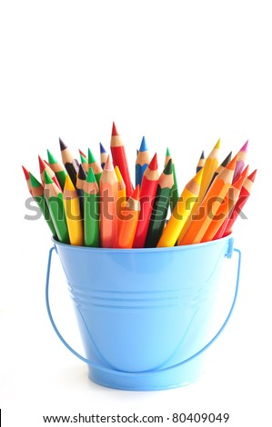 Blue bucket with color pencils - stock photo