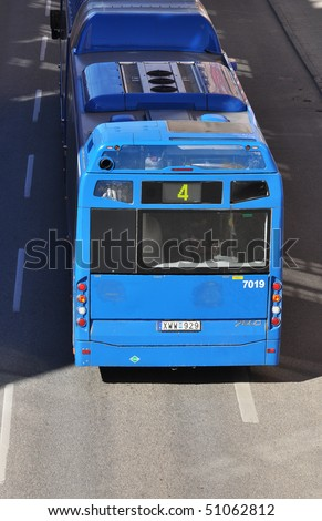 Blue bus in traffic. - stock photo