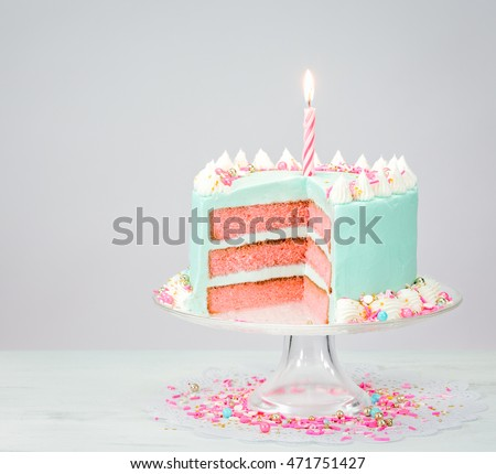 Blue Buttercream Birthday Cake With Pink Layers And Sprinkles