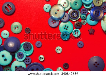 blue buttons - composition on a red background - stock photo