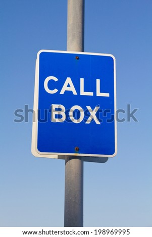 blue call box sign in pole