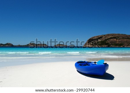 Blue canoe on a beautiful Australian sandy beach - stock photo