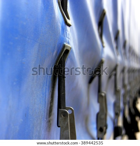 Blue canvas truck or lorry covering with buckles