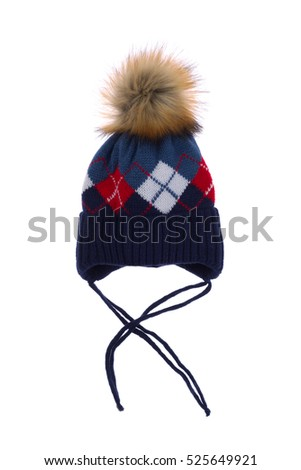 Blue cap with a pattern and a fur pompon, isolate on a white background