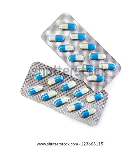 Blue capsules in two packs isolated on white background - stock photo