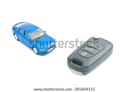 blue car and car keys with alarm on white