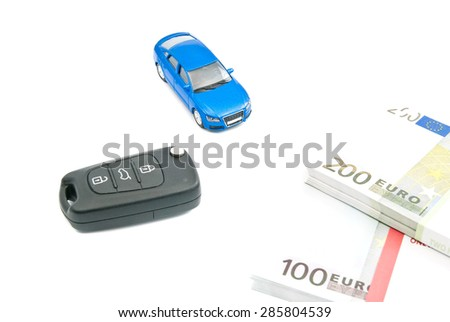 blue car, black car keys and euro notes on white - stock photo