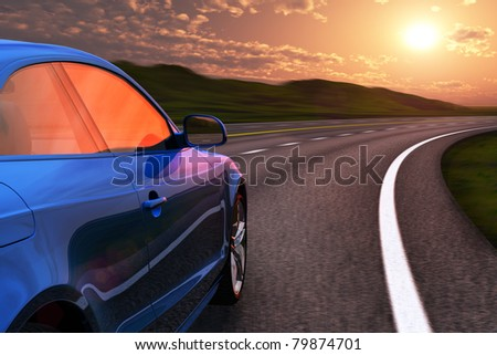 Blue car driving by autobahn in sunset with motion blur effect - stock photo