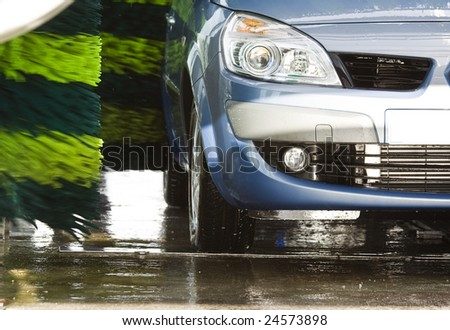 Blue car during washing process